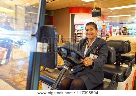 SINGAPORE - NOVEMBER 03, 2015: staff at Changi airport. Singapore Changi Airport, is the primary civilian airport for Singapore, and one of the largest transportation hubs in Southeast Asia