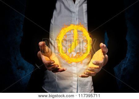 Businesswomans hands presenting against dark background