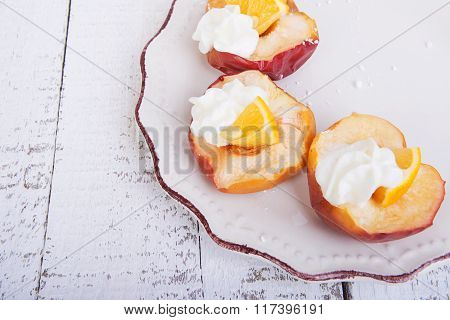 Baked Apples On A Plate With Lemon And Citrus Puree Of Apples And Pumpkins