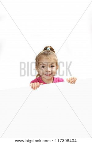 The Little Girl Looks Out Because Of A Sheet Of Paper