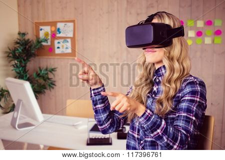 Pretty casual worker using oculus rift against creative office with cool wooden paneling