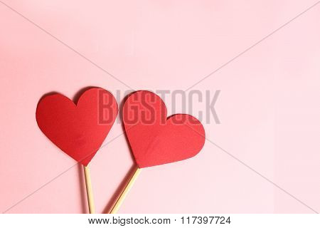 Two Red Paper Heart On Wooden Stick Together