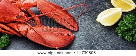 Fine Selection Of Crustacean For Dinner. Steamed Lobster With Lemon