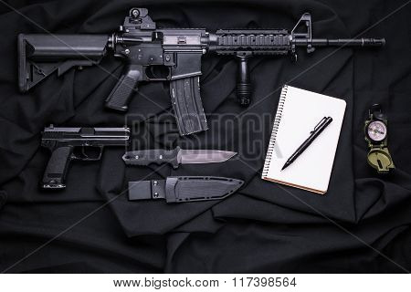 Top View On The Weapon, Compass And Notepad