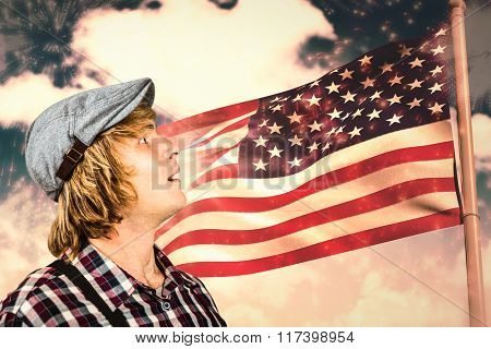 Shocking man looking at an american flag