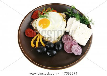 egg served on dark dish with vegetables