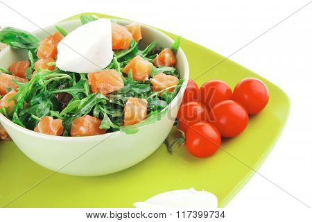 fresh green salad with smoked salmon on plate