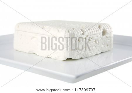 whole soft cheese on dishware isolated over white