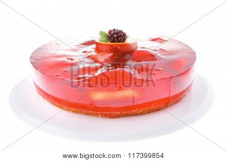 sweet cold red jelly cake with fruits and blackberry