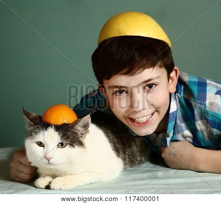 Preteen Boy With Male Cat In Funny Orange Cap