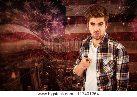 Portrait of businessman pointing while standing against composite image of digitally generated united states national flag