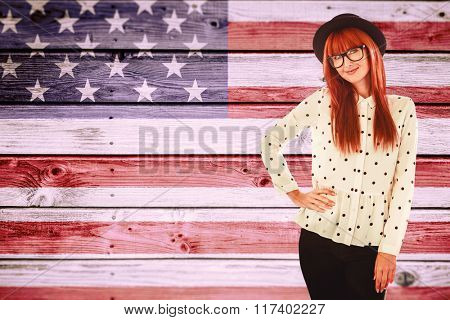Portrait of a smiling hipster woman against composite image of usa national flag