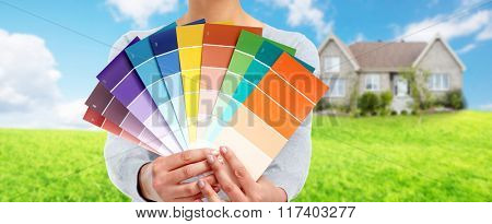 Woman with painting colors.