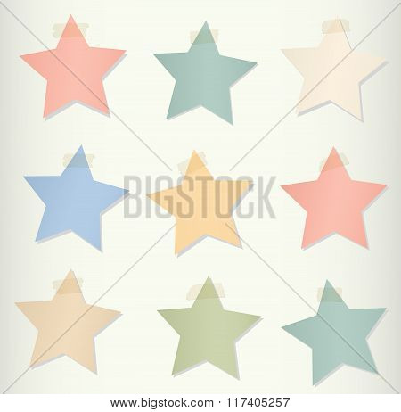 Colorful paper stars stick on light background