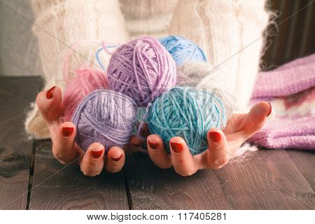 Hands Holding A Balls Of Yarn