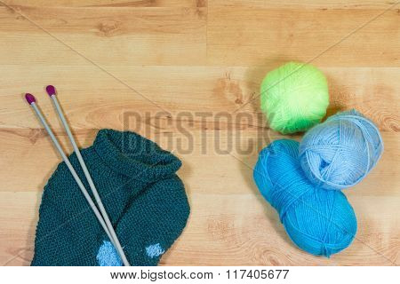 Knitting Tools On The Wooden Desk