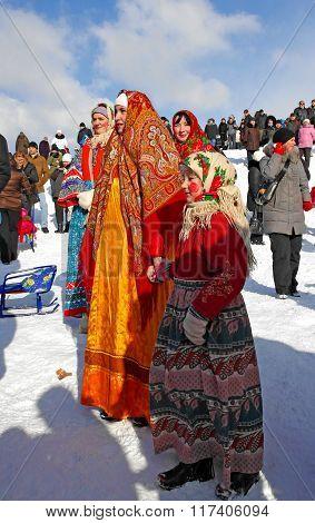 Gatchina, Leningrad region, RUSSIA - March 5, 2011: Maslenitsa. Girls in folk costumes.
