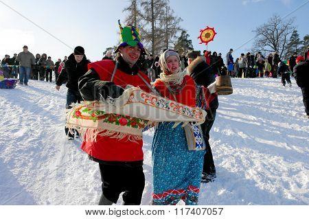 Gatchina, Leningrad region, RUSSIA - March 5, 2011: Maslenitsa. Clowns entertain the public holiday
