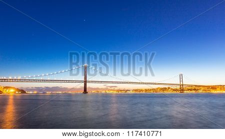 Lisbon city scape with Bridge, Portugal at dusk