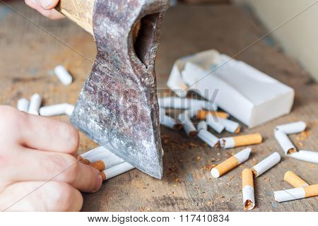 Anti-smoking background. Chopped cigarettes