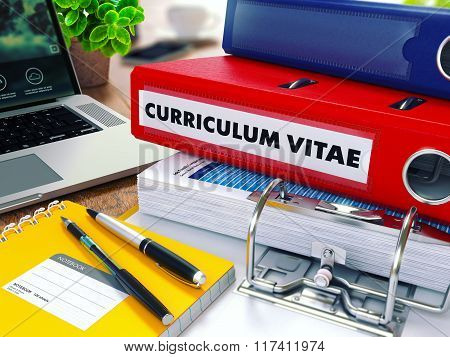 Curriculum Vitae on Red Ring Binder. Blurred, Toned Image.