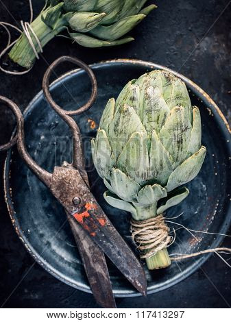 Top View Artichoke Still Life With Vintage Scissors
