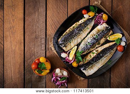 Baked Mackerel With Herbs And Garnished With Lemon And Pickled Vegetables. Top View