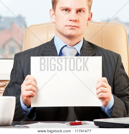 Young businessman holding blank paper