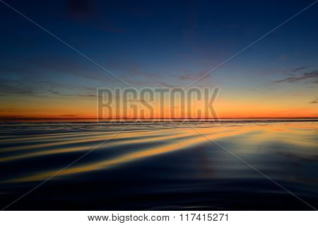 Calm open Baltic sea at the sunset