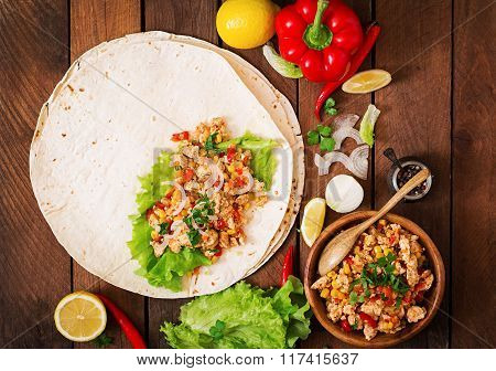 Ingredients For Burritos Wraps Chicken Meat, Corn, Tomatoes And Peppers On Wooden Background. Top Vi