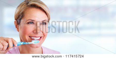 Beautiful senior woman with a toothbrush.