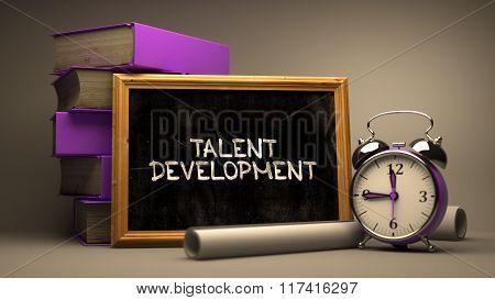 Hand Drawn Talent Development Concept on Chalkboard.