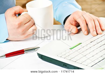 closeup of a businessman`s hands working with notebook