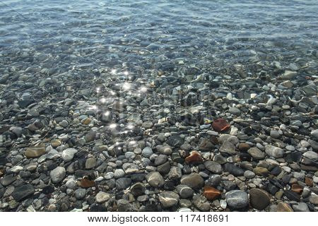 Gravel stones at the sea bottom near the coastline.