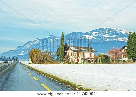 Road View Of Houses In Snow Covered Switzerland