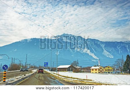 Road View To Village In Snow Covered Switzerland