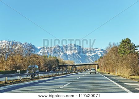 View From Road To Snow Covered Swiss Mountains