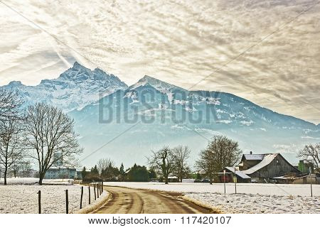 Road View Of Village In Snow Covered Switzerland