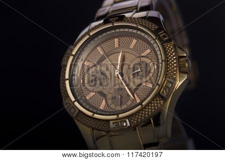 Gold Watch On A Plastic Background
