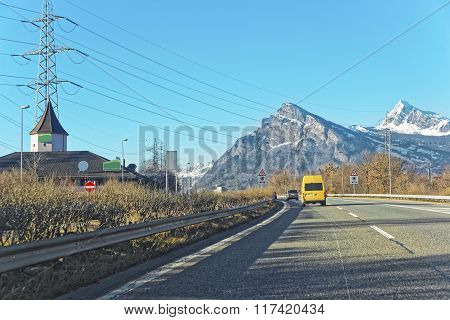 Road With Car And Electricity Transmission Lines In Winter Switzerland