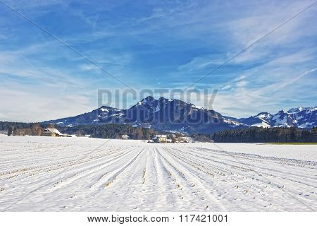 Landscape Of Countryside In Snow Covered Switzerland In Winter