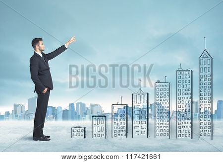 Business man climbing up on hand drawn buildings in city concept