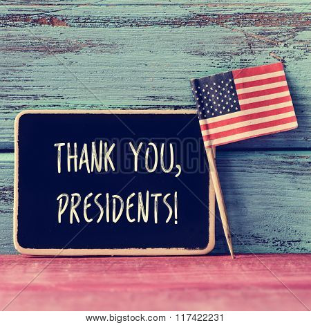 the text thank you presidents written in a chalkboard and a flag of the United States, on a blue and red rustic wooden background