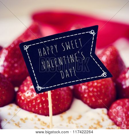 closeup of a cake topped with strawberries and a black flag-shaped signboard with the text happy sweet valentines day written in it