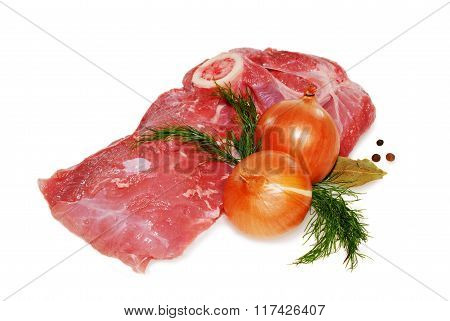 raw pork meat on the bone with onion and herbs isolated against white background