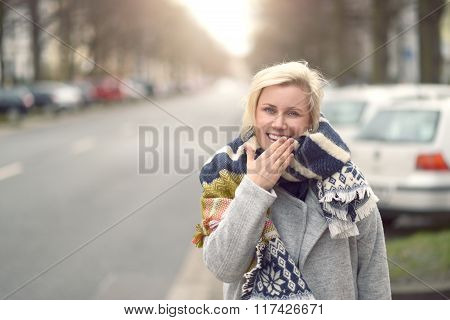 Smiling Attractive Young Woman In A Woolly Scarf