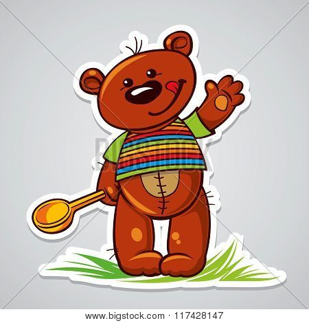 Lovely teddy bear holding a spoon