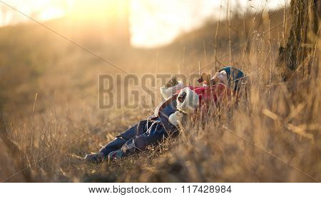 Young Happy Boy Playing Outdoor. Boy Lying In Grass And Dreaming