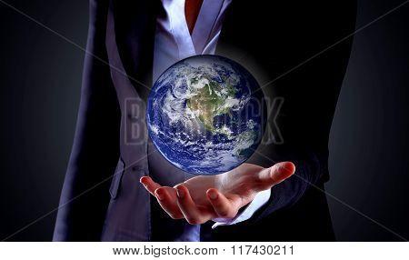 hand holding globe