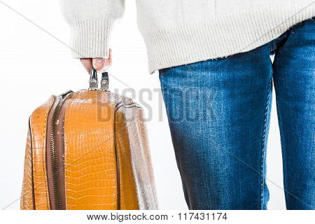 Somebody Holding A Suitcase